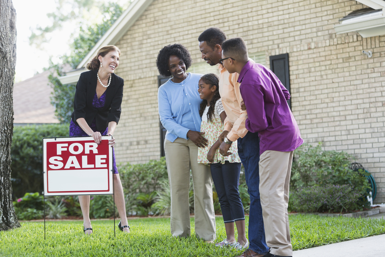 family of four looking at a house they want to buy